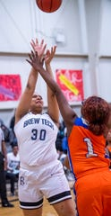 Brewbaker Tech's Jurnee Webster (30) shoots against Valley's Starbresha Core (1) at the BrewTech campus in Montgomery, Ala., on Thursday February 7, 2019.
