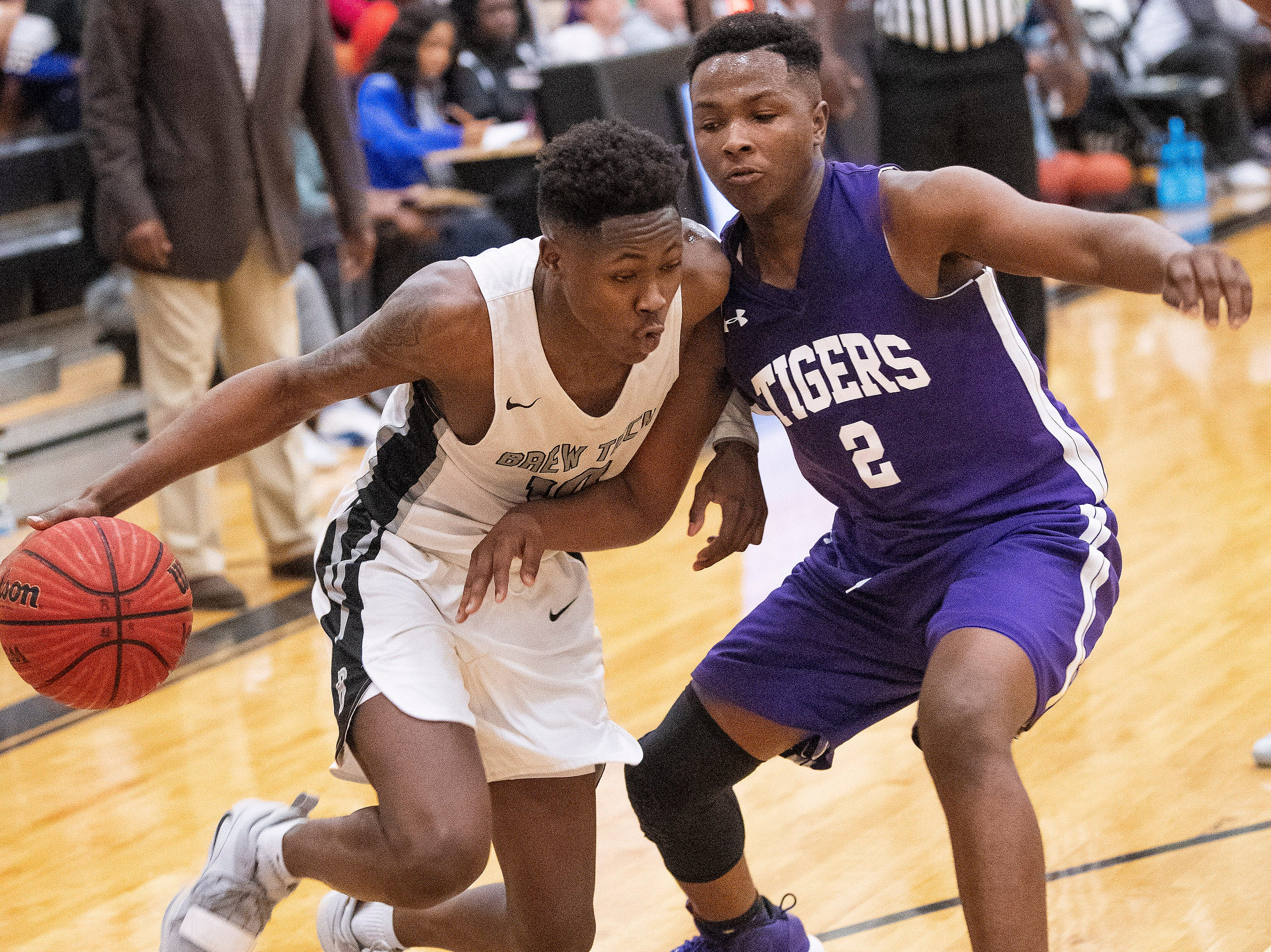 Brewbaker Tech's Desmond Williams (10) against Tallassee's Sandarius Hughley (2) at the BrewTech campus in Montgomery, Ala., on Thursday February 7, 2019.