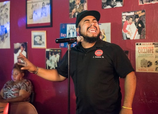 Jonathon Peterson performs spoken word poetry at A Touch of Soul Cafe in Montgomery, Ala., on Thursday, Feb. 7, 2019.