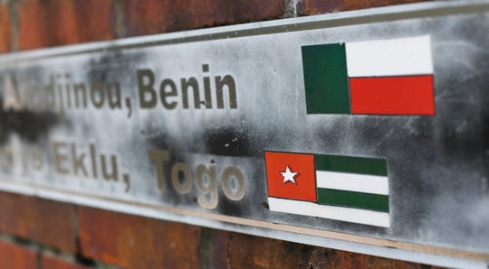 The flags of the nations of Benin and Togo, the west African homes of the survivors of the Clotilda, remain on display on a monument at what was the Africatown Welcome Center in Mobile, Ala., on Tuesday, Jan. 29, 2019. The center was destroyed by Hurricane Katrina in 2005, and hasn't been rebuilt. (AP Photo/Julie Bennett)