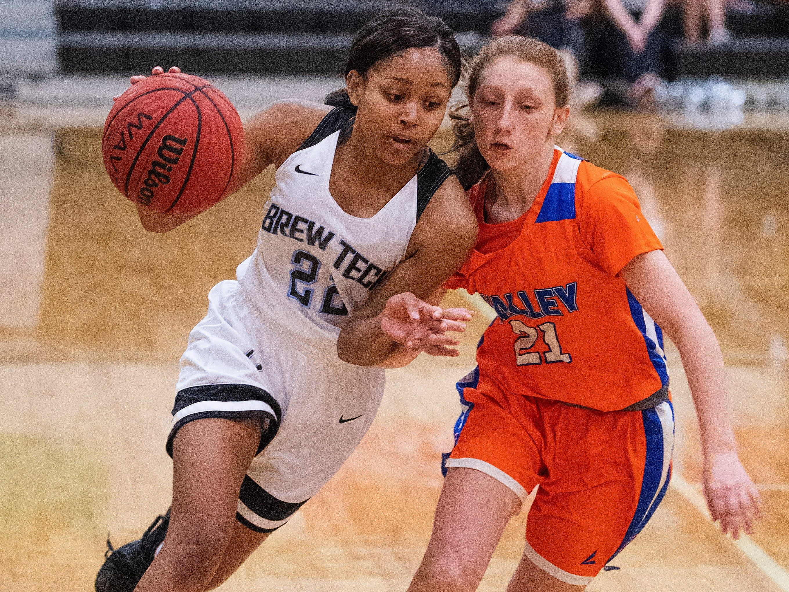 Brewbaker Tech's Curtise Forte' (22) drives against Valley's Madison Chandler (21) at the BrewTech campus in Montgomery, Ala., on Thursday February 7, 2019.
