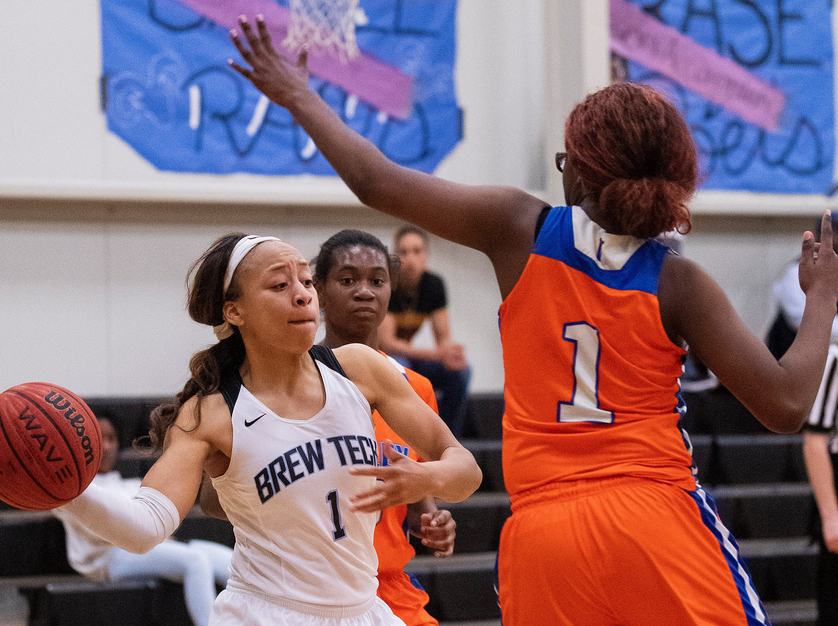 Brewbaker Tech's Taylor Sharpe (1) passes against Valley's Starbresha Core (1) at the BrewTech campus in Montgomery, Ala., on Thursday February 7, 2019.