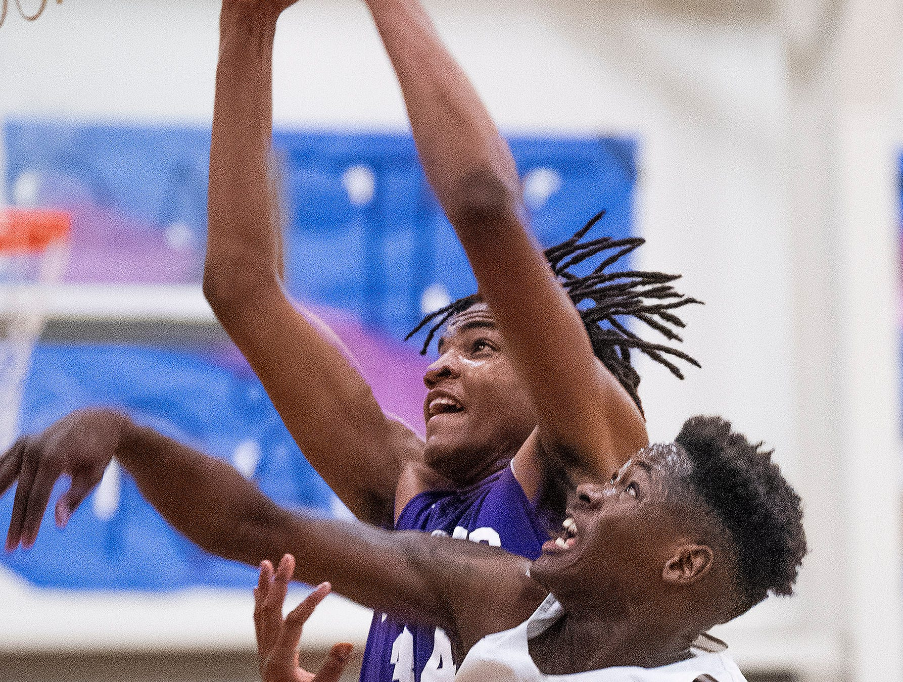 Tallassee's Tyrek Turner (34) grabs a rebound over Brewbaker Tech's Desmond Williams (10) at the BrewTech campus in Montgomery, Ala., on Thursday February 7, 2019.