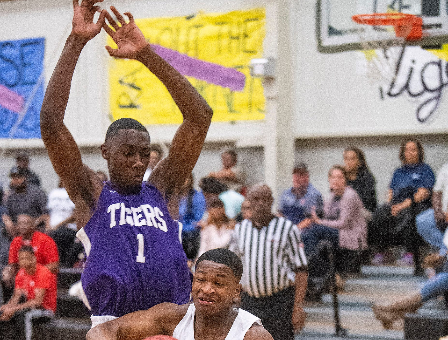 Tallassee's Kalvin Levett (1) against Brewbaker Tech's Mike Davis, Jr., (12) at the BrewTech campus in Montgomery, Ala., on Thursday February 7, 2019.