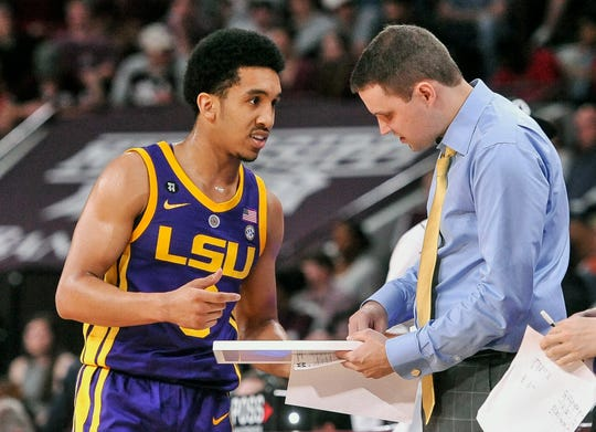 LSU guard Tremont Waters (3) and head coach Will Wade talk during a game against Mississippi State on Feb. 6, 2019, in Starkville, Miss.