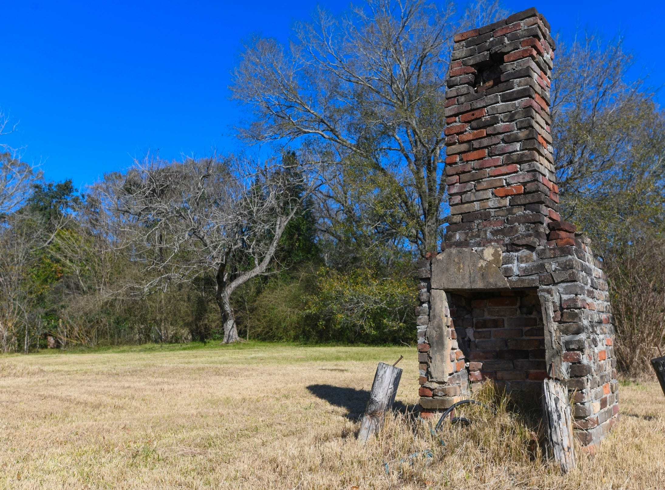 A chimney, the last remaining original structure from the days when survivors of the Clotilda, the last known slave ship brought into the United States, inhabited the area, stands in an abandoned lot in Africatown in Mobile, Ala., on Tuesday, Jan. 29, 2019. After years of watching the steady decline, descendants of the freed slaves who established Africatown are trying to create new ties and, perhaps, rebuild a community that's in danger of fading away. (AP Photo/Julie Bennett)