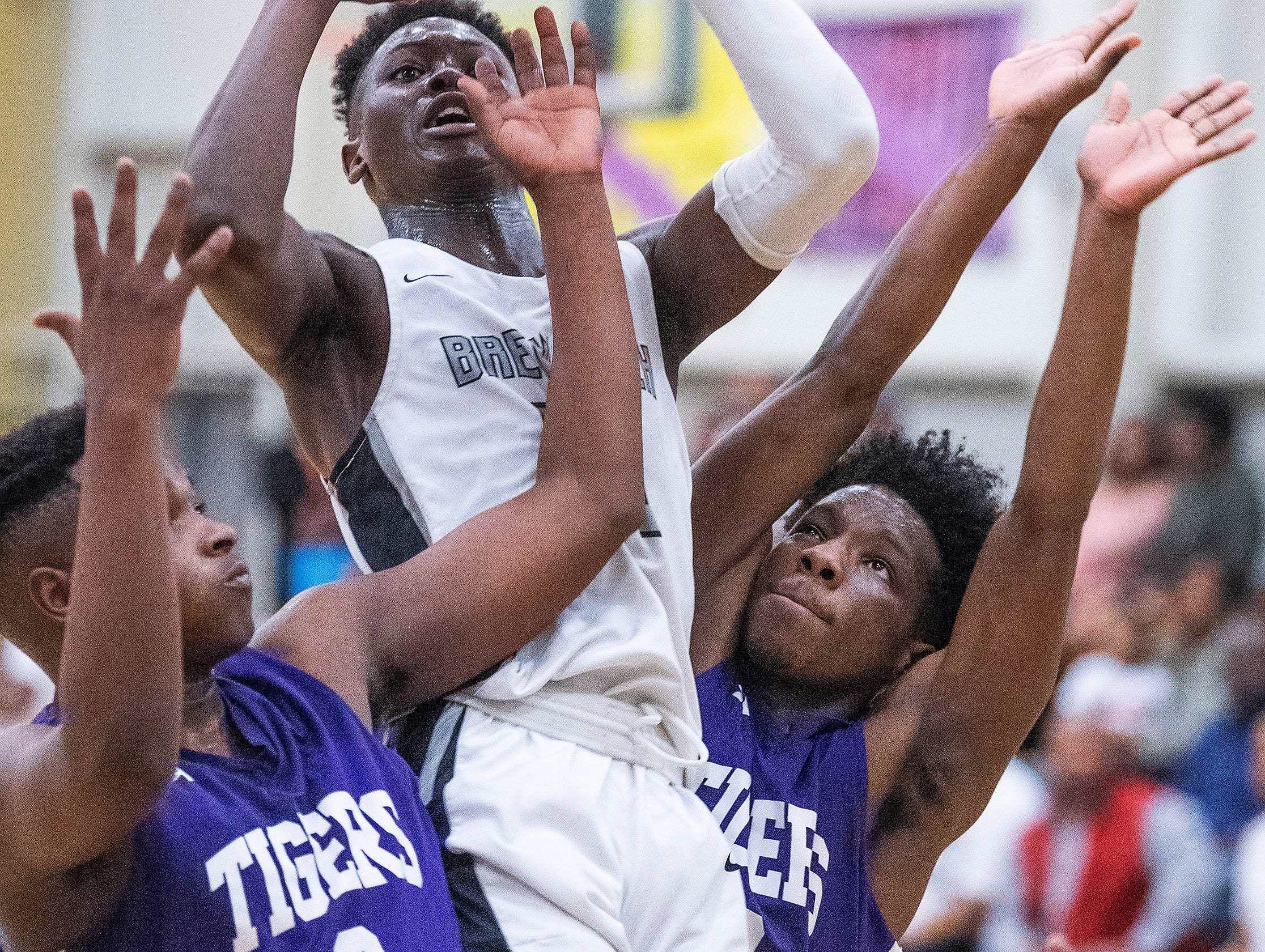 Brewbaker Tech's Desmond Williams (10) is double teamed by Tallassee's Sandarius Hughley (2) and Jaleel Dumas (3) at the BrewTech campus in Montgomery, Ala., on Thursday February 7, 2019.