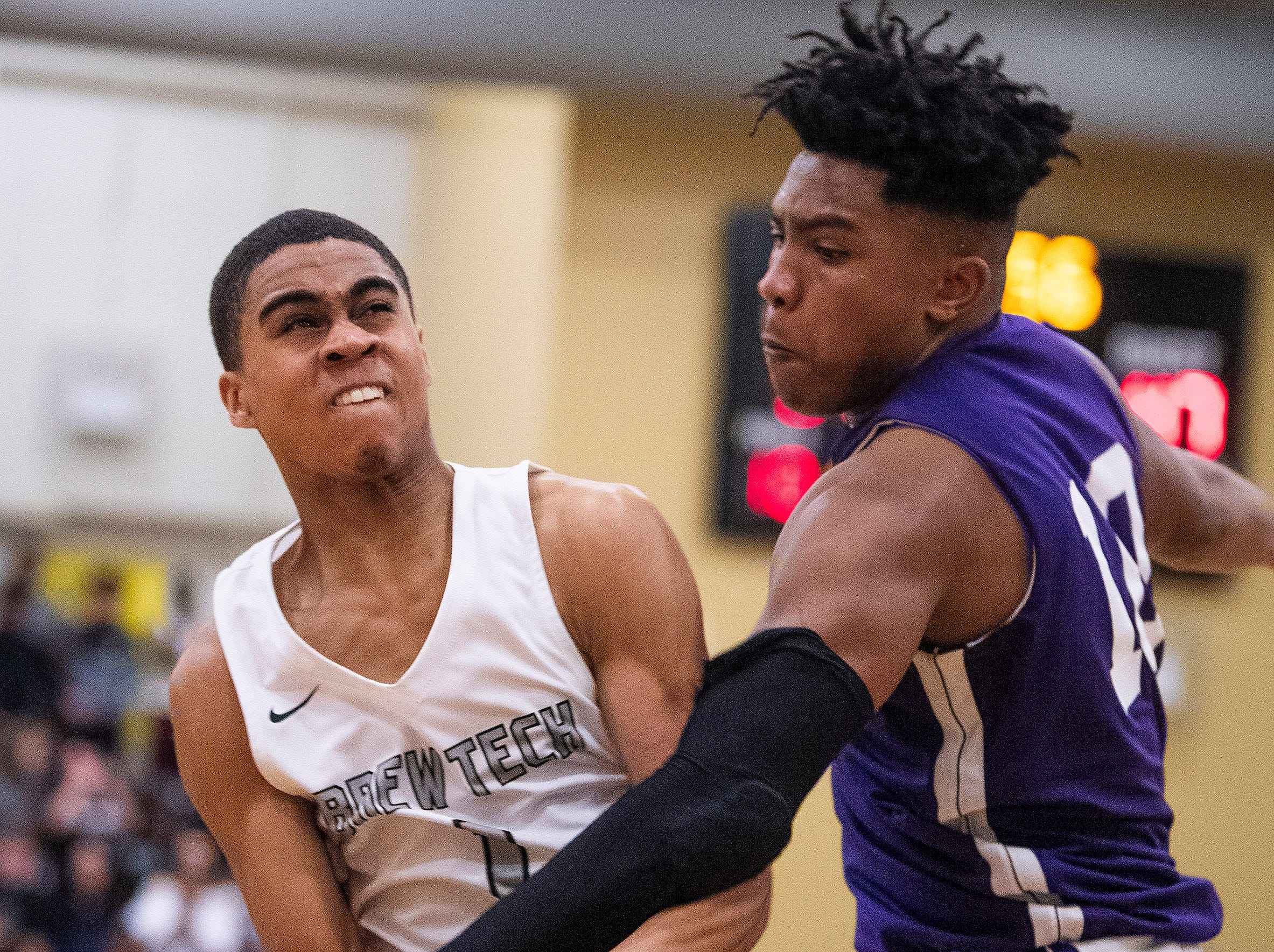 Brewbaker Tech's Evan Carter (1) is fouled by Tallassee's Tavarious Griffin (10) at the BrewTech campus in Montgomery, Ala., on Thursday February 7, 2019.