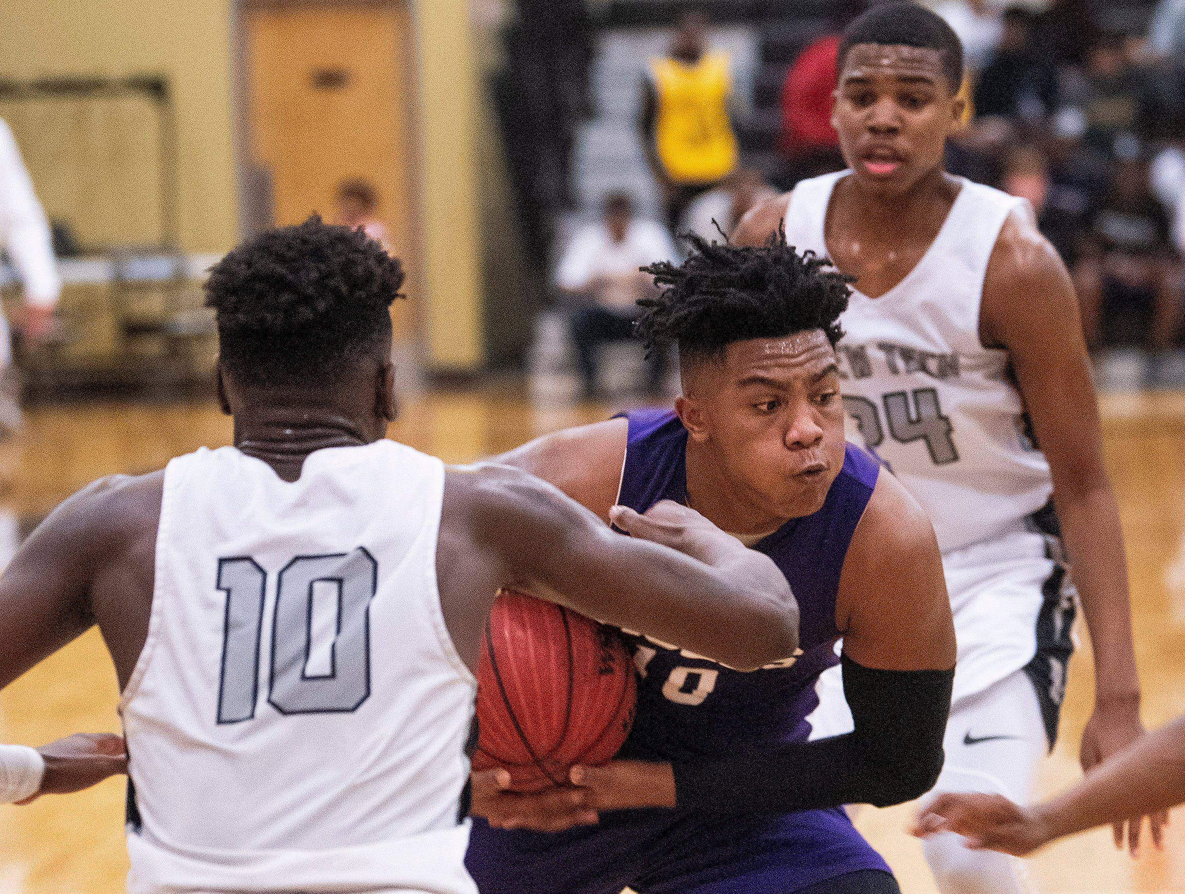 Tallassee's Tavarious Griffin (10) is double teamed by Brewbaker Tech's Desmond Williams (10) and Justin Johnson (24) at the BrewTech campus in Montgomery, Ala., on Thursday February 7, 2019.