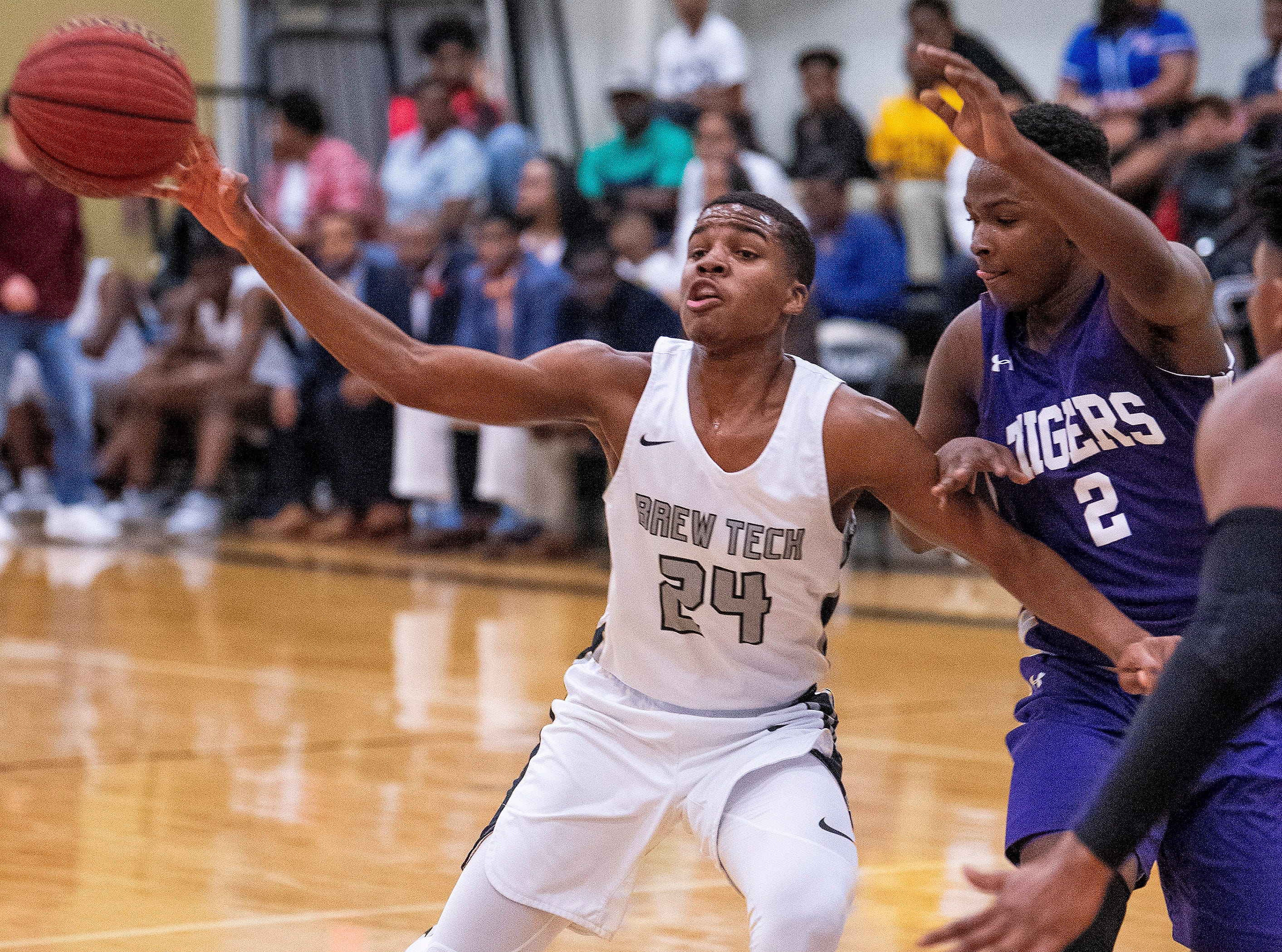 Brewbaker Tech's Justin Johnson (24) passes against Tallassee's Sandarius Hughley (2) at the BrewTech campus in Montgomery, Ala., on Thursday February 7, 2019.