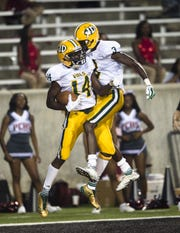 Jeff Davis' Brandon Sanders (3) and Jeff Davis' Tavares Womack (14) celebrate after Jeff Davis' Tavares Womack (14) scored a touchdown during the game Friday, Aug. 25, 2017, in Montgomery, Ala.