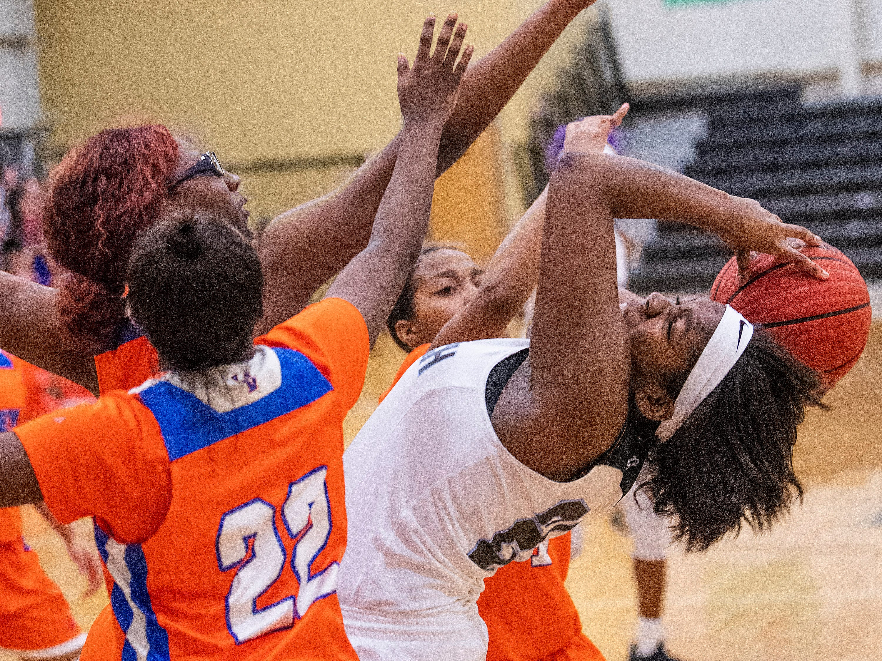 Brewbaker Tech's Nina Johnson (20) against Valley's Roniaseia Cofield (22) at the BrewTech campus in Montgomery, Ala., on Thursday February 7, 2019.
