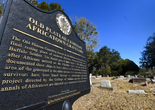 Old Plateau Cemetery, the final resting place for many who spent their lives in Africatown, stands in need of upkeep near Mobile, Ala., on Tuesday, Jan. 29, 2019. Many of the survivors of the Clotilda's voyage are buried here amongst the trees. (AP Photo/Julie Bennett)