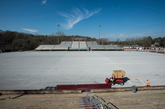 Crews work on replacing the turf field at Stanley Jensen Stadium in Prattville, Ala., on Thursday, Feb. 7, 2019.