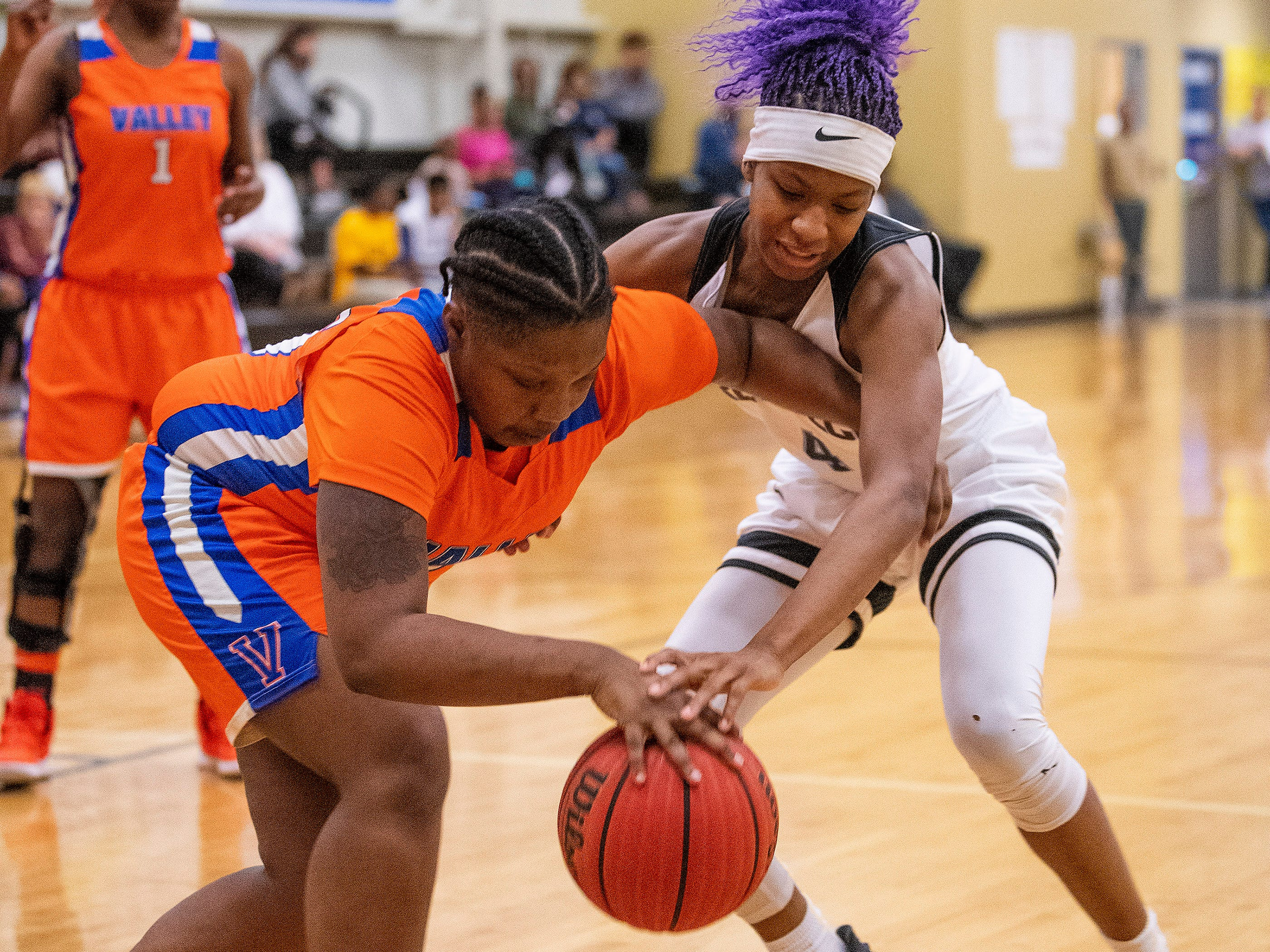 Valley's Emerald Floyd (15) and Brewbaker Tech's Skye Harris-Butler (4) go after the ball at the BrewTech campus in Montgomery, Ala., on Thursday February 7, 2019.