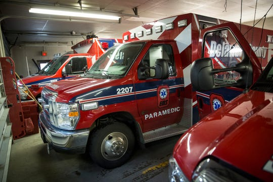 Ambulances head in and out of the downtown EMS station Friday, Feb. 8. The City of Muncie is looking into forming their own ambulance service by buying 3 ambulances for the fire department, though officials disagree on the impact this would have on DCEMS.