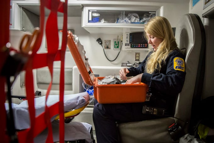 April Hart, an EMT with Delaware County EMS, works on restocking and readying an ambulance after a run in the morning on Friday, Feb. 8. The City of Muncie is looking into forming their own ambulance service by buying 3 ambulances for the fire department, though officials disagree on the impact this would have on DCEMS.