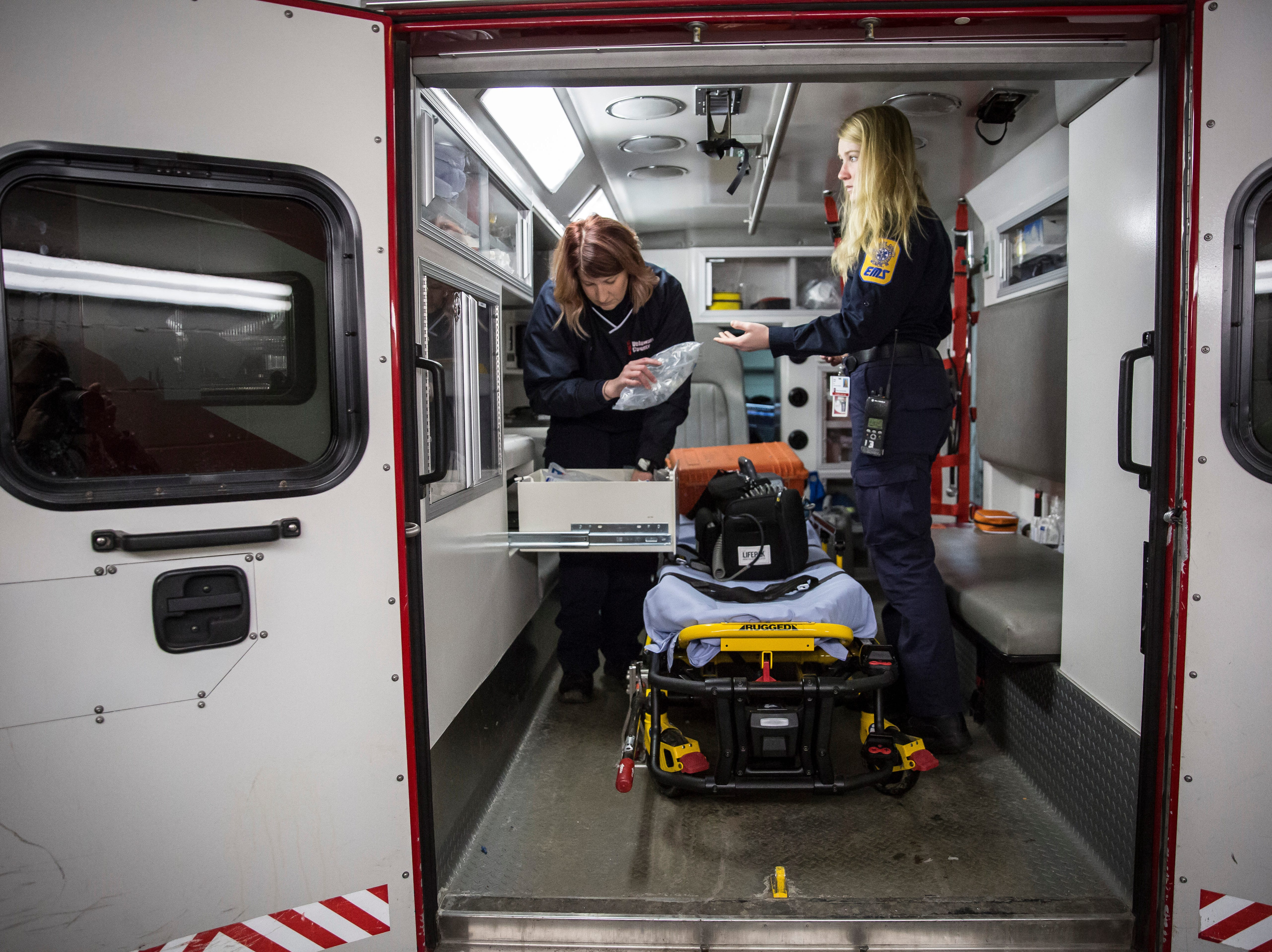 Blair Scott, paramedic with Delaware County EMS, and EMT April Hart work on restocking and readying their ambulance after a run in the morning on Friday, Feb. 8. The City of Muncie is looking into forming their own ambulance service by buying 3 ambulances for the fire department, though officials disagree on the impact this would have on DCEMS.