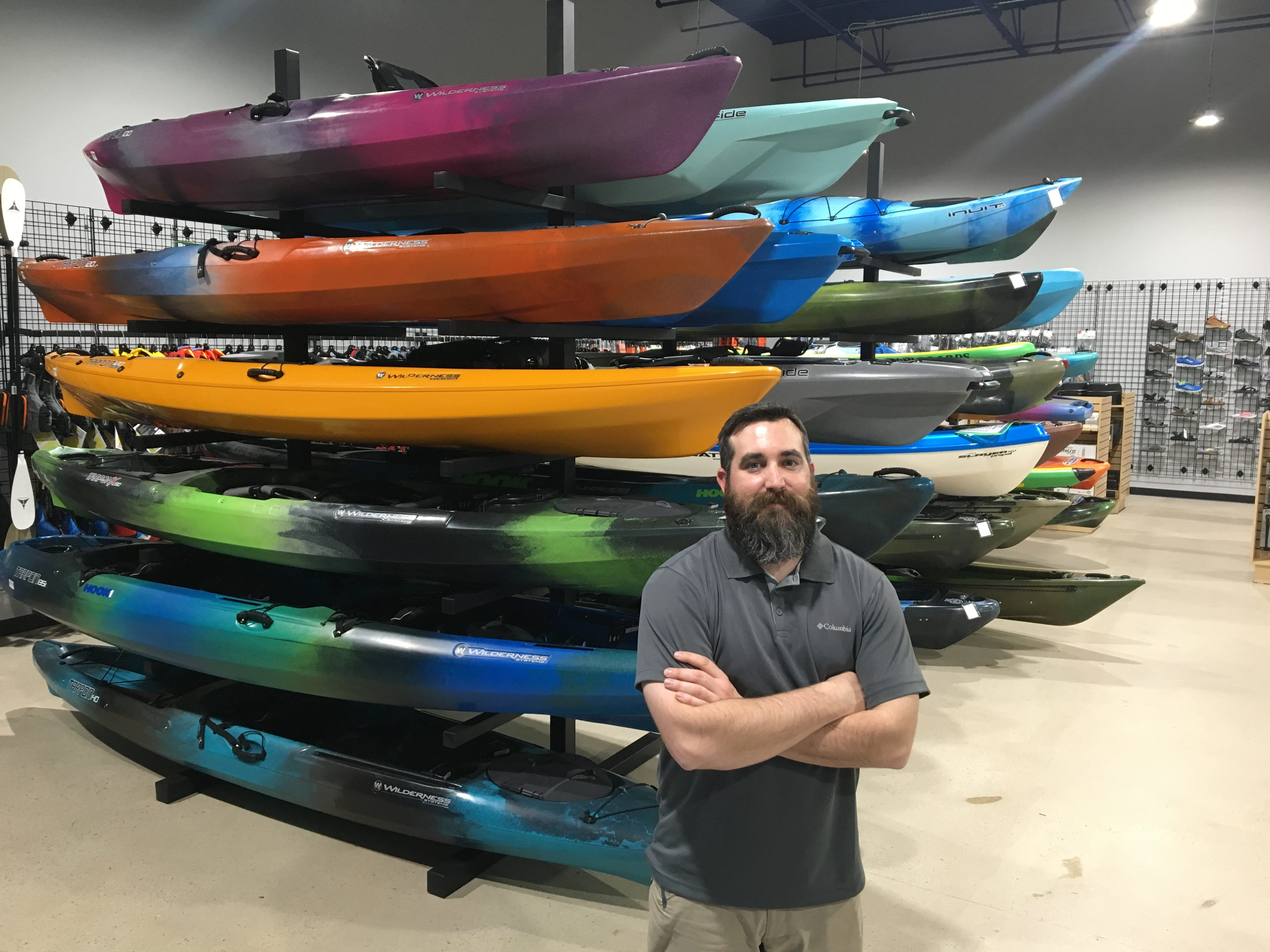 Chris Conder, manager of the new Murfreesboro Hook 1 outfitters, stands in front of a display of top-of-the-line kayaks.