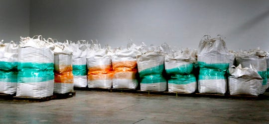 Bags of dried hemp flowers from different growers are stored at the BenMar International Group facility on Wednesday, Jan. 31, 2019.