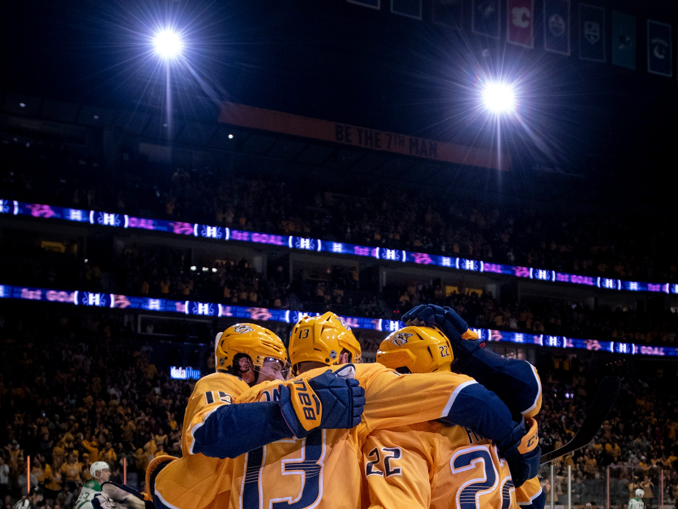 Nashville Predators right wing Craig Smith (15, left) reacts to scoring against the Dallas Stars during the first period at Bridgestone Arena in Nashville, Tenn., Thursday, Feb. 7, 2019.