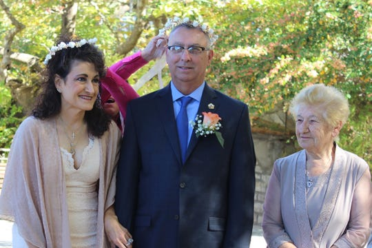 Linda Carol Trotter and her husband, Robert, stand with the bride's birth mother, Charikleia Noula Foka, during the Trotters' 25th wedding anniversary vow renewal ceremony on the village square in Stranoma, Greece, on Oct. 10, 2017.