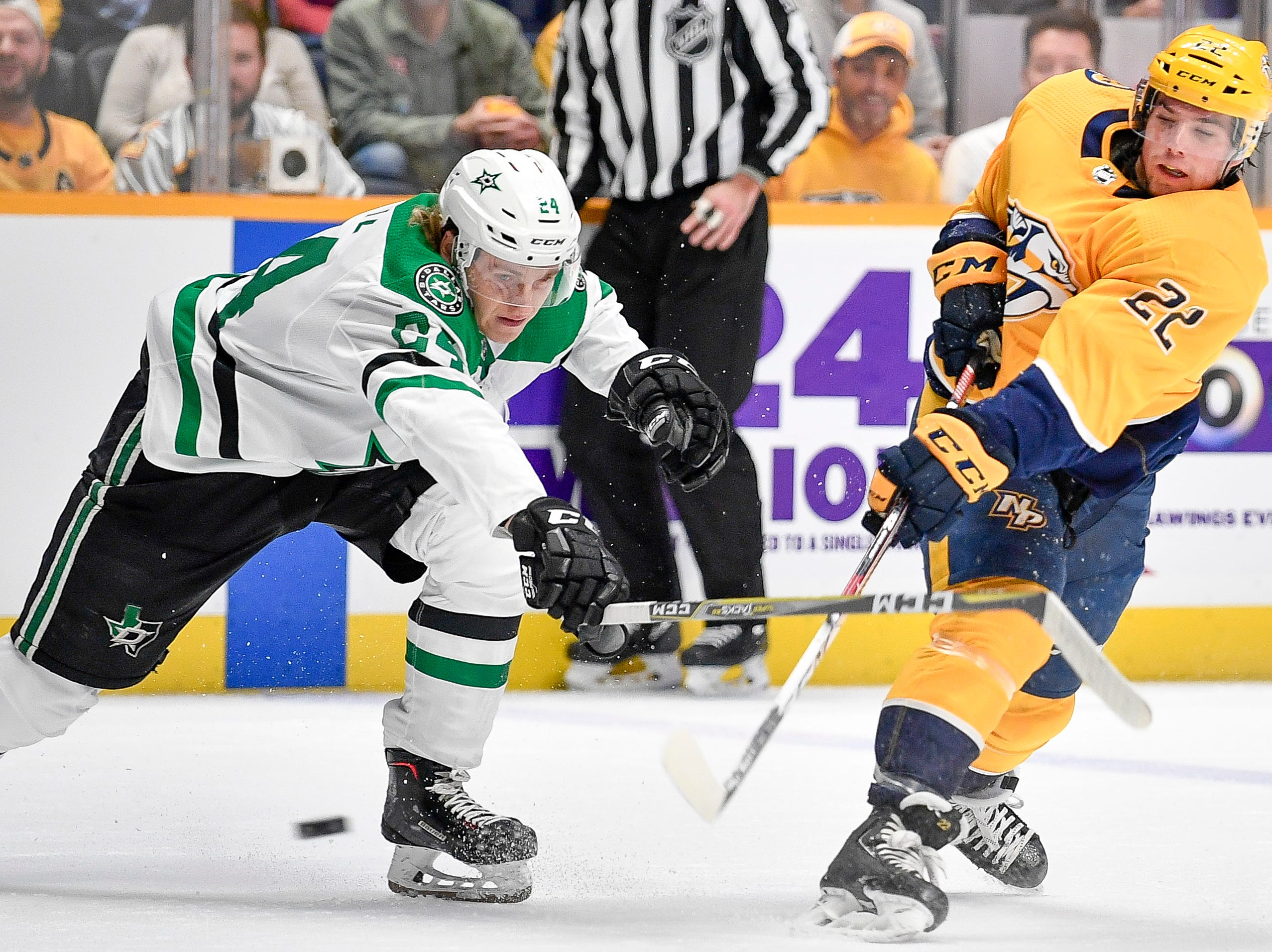 Nashville Predators left wing Kevin Fiala (22) shoots past Dallas Stars left wing Roope Hintz (24) during the first period at Bridgestone Arena in Nashville, Tenn., Thursday, Feb. 7, 2019.