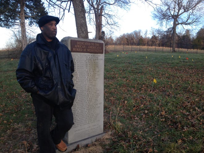 John Baker, Jr. watches as work gets underway in the slave cemetery at Wessyngton. Baker, a guest curator of the upcoming Wessyngton exhibit at the Tennessee State Museum, has studied the plantation for more than 30 years. His ancestors were enslaved on the property.
