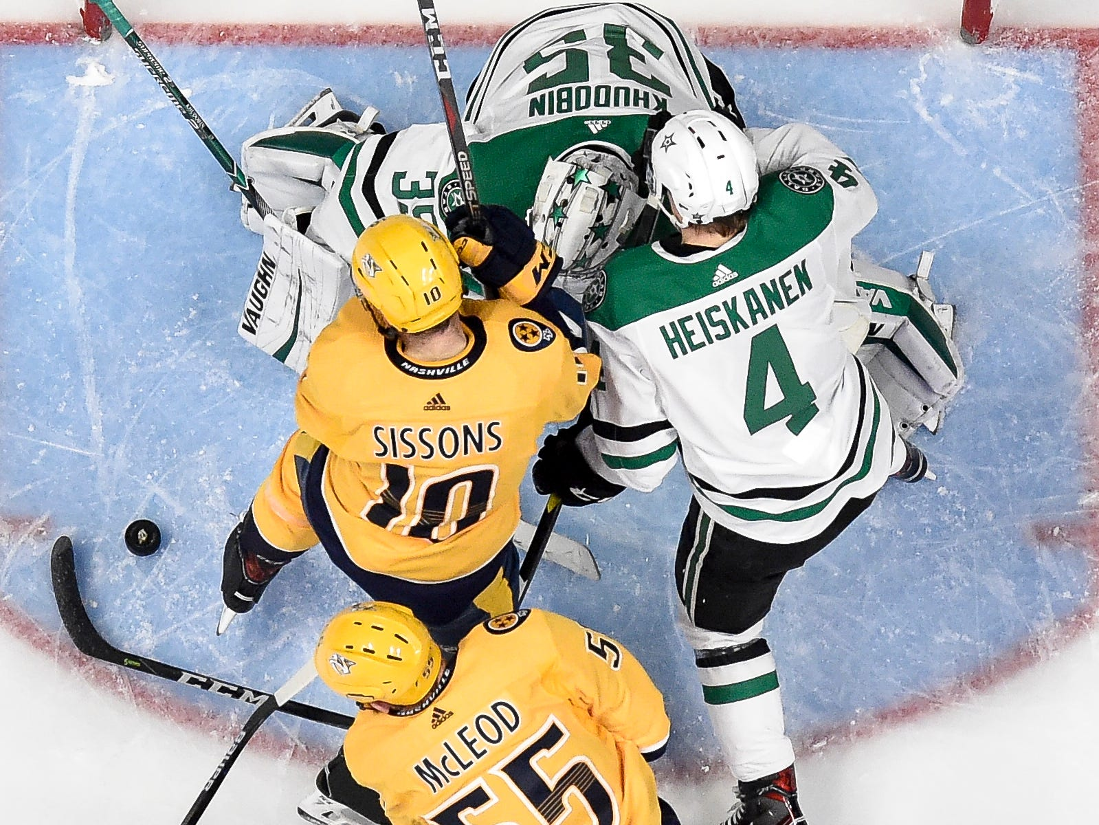 Dallas Stars goaltender Anton Khudobin (35) and defenseman Miro Heiskanen (4) defend against Nashville Predators center Colton Sissons (10) and left wing Cody McLeod (55) during the second period at Bridgestone Arena in Nashville, Tenn., Thursday, Feb. 7, 2019.