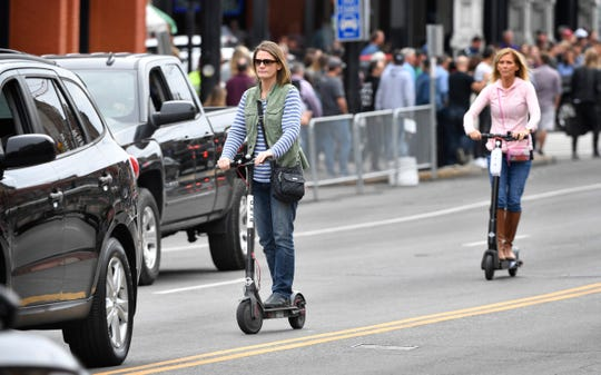 Lime and Bird scooters have taken over downtown areas in many of Tennessee's major cities Friday, Oct. 12, 2018, in Nashville, Tenn.