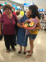 Linda Carol Trotter, right, hugs her birth mother, Charikleia Noula Foka, after the two saw each other for the first time since Trotter's birth in 1958. Trotter's aunt, Georgia Kalogeris, looks on at the Athens International Airport in Greece on June 16, 2017.