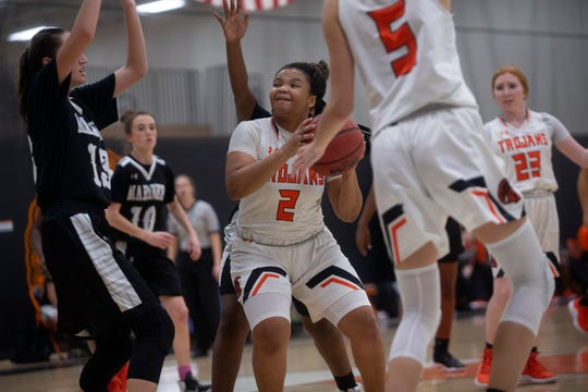 Lely High School's Cherrie Terry drives to the basket against Mariner High School in the Class 6A-District 12 championship game on Thursday at Lely.