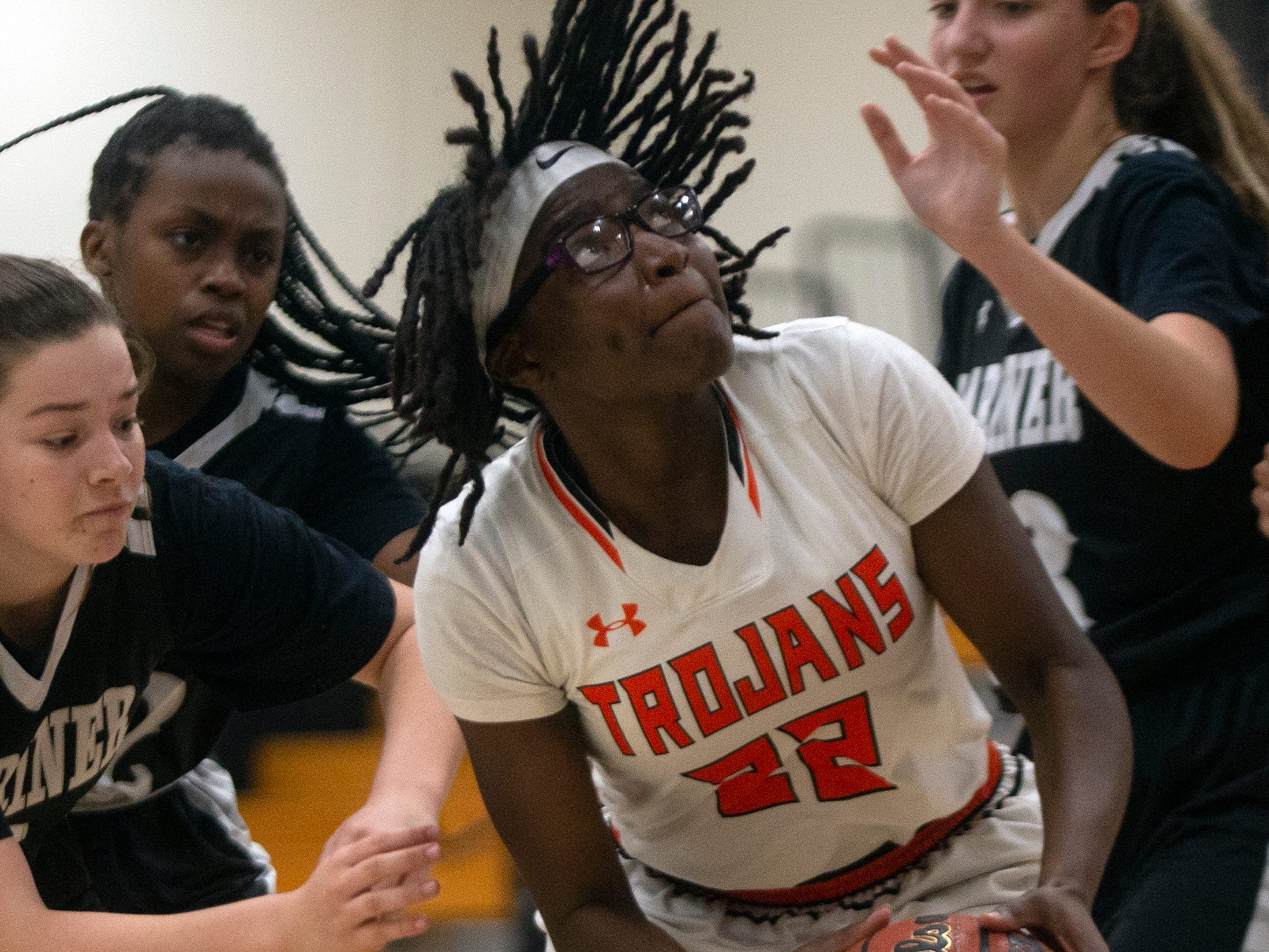 Lely High School's Kenya Stuart maneuver under the basket during their basketball game against Mariners High School, Thursday, Feb. 6, 2019, at Lely High School.