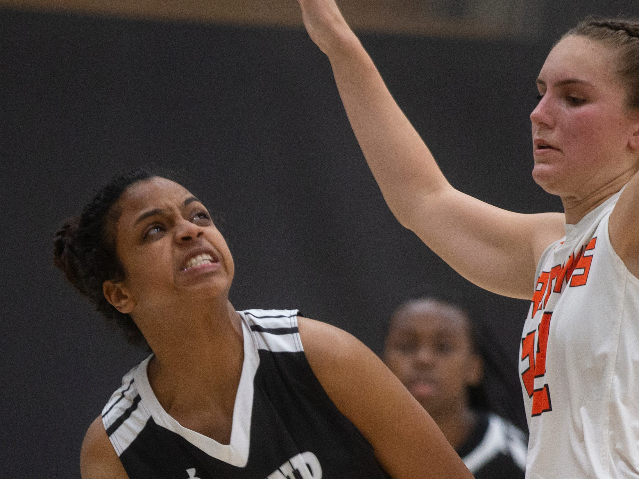 Mariners High School's Alana Lozada holds on the ball while defended by Lely High School's Katie Miller, Thursday, Feb. 6, 2019, at Lely High School.