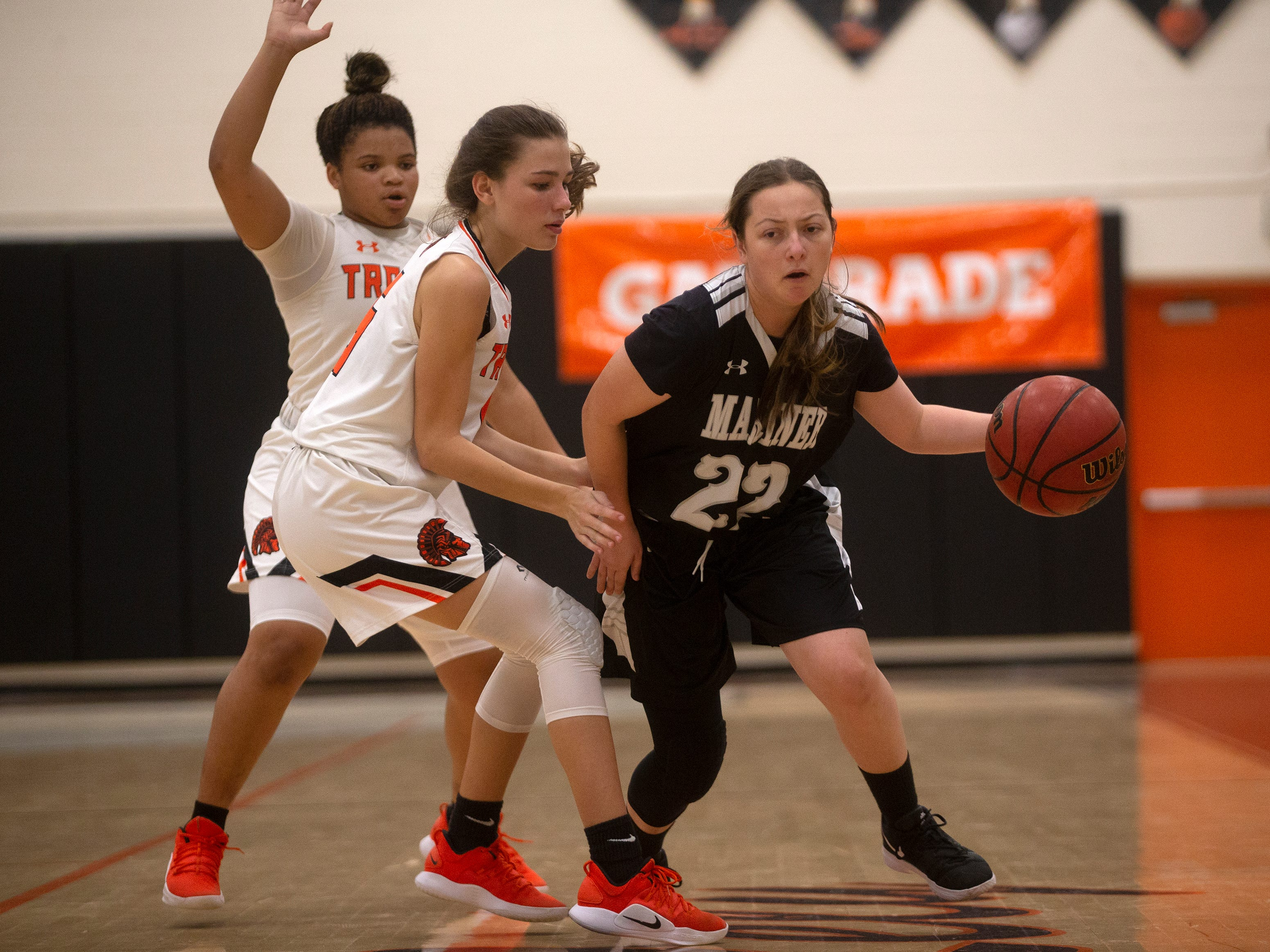 Mariners High School's Kelli-Anne Suthard moves the ball down the court during their game against Lely High School, Thursday, Feb. 6, 2019, at Lely High School.