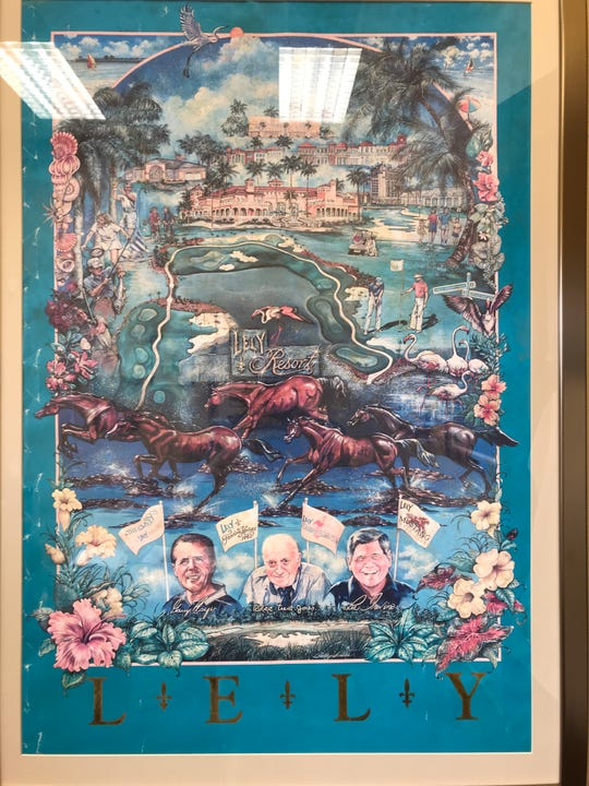 A poster from the 1996 Greater Naples IntelliNet Challenge played at The Classics Country Club at Lely Resort hangs in the office of regional manager David Leverant.