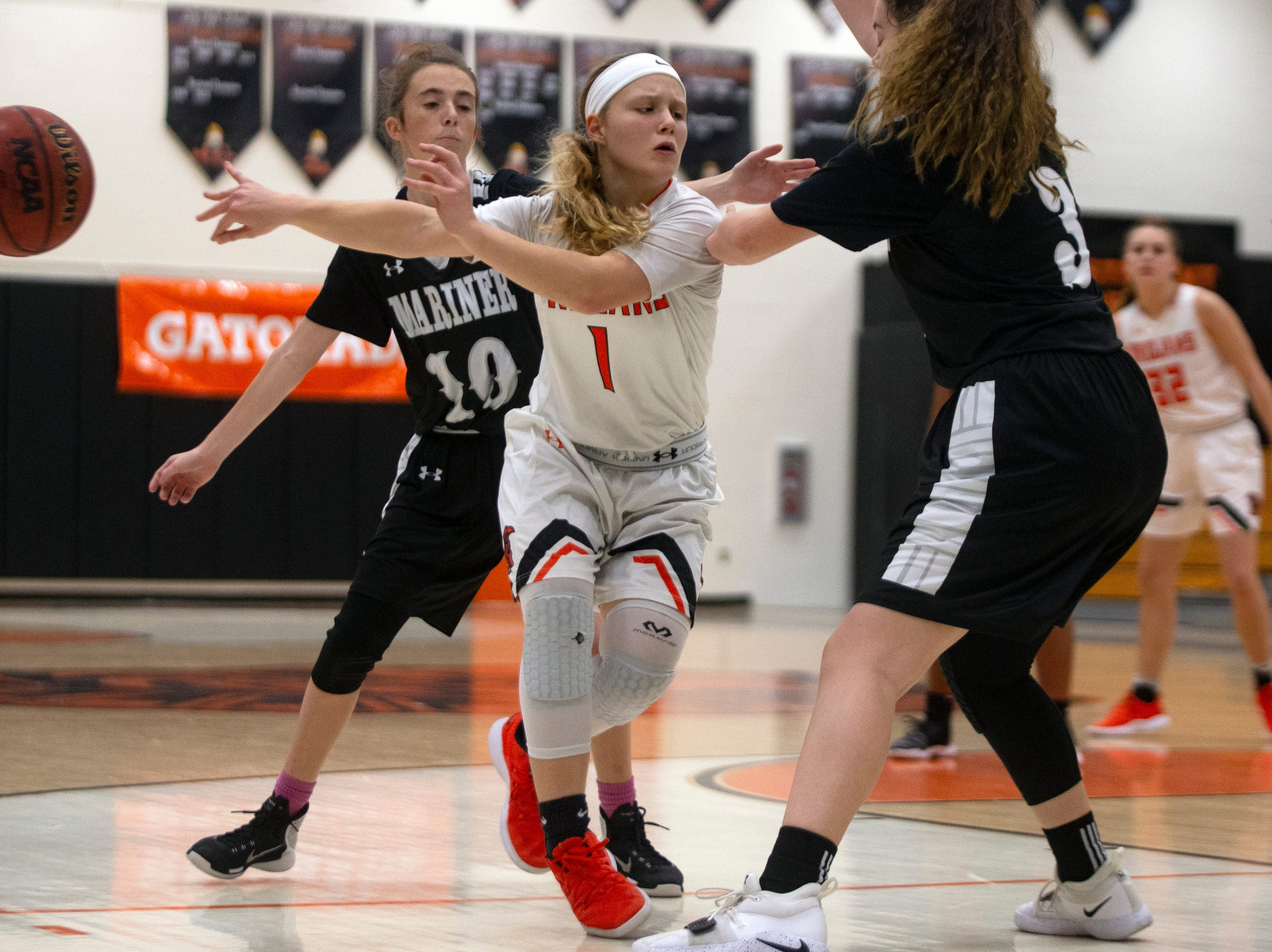 Lely High School's Gabby Wetzel passes the basketball during their game against Mariners High School, Thursday, Feb. 6, 2019, at Lely High School.