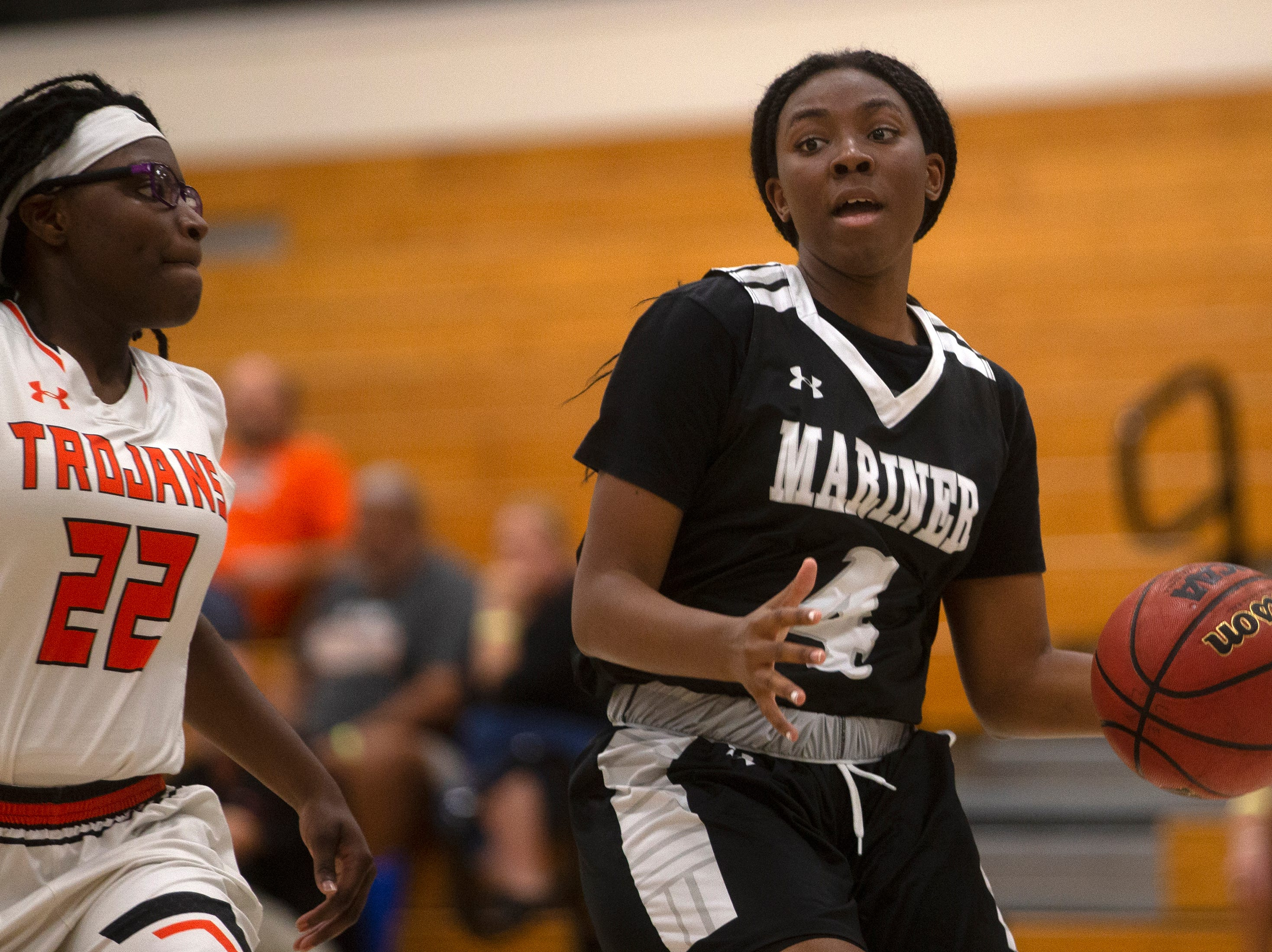 Mariners High School's Naomi Darrett dribbles the ball while guarded by Lely's Kenya Stuart, Thursday, Feb. 6, 2019, at Lely High School.