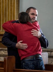 Kathy Mosholder hugs Doug Barcus after Tyler Ocasio was found guilty on all counts, including aggravated murder, in the death of David Earl Barcus last January. Mosholder was in the house when four men, including Ocasio, broke in and killed Barcus in his sleep.