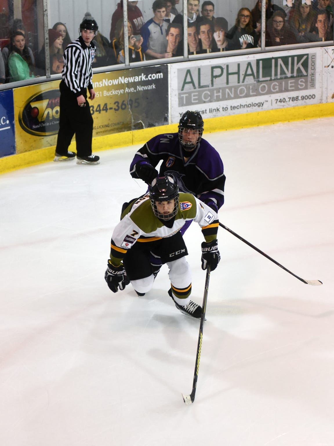 Tri-Valley sophomore Drew Johnson skates away from a defender during the Newark Generals' 5-1 win against the PHA Prowlers on Feb. 7 at Lou and Gib Reese Ice Arena.