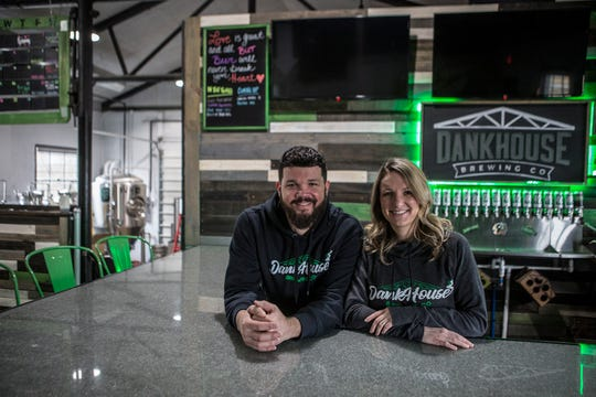 Josh and Heather Lange pose for a photo in their brewery/bar on Forry Street, Dankhouse Brewing.