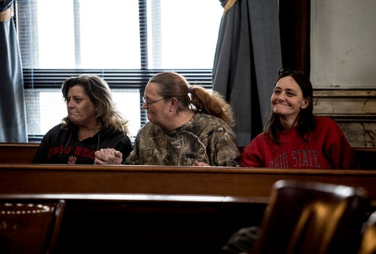 Evelyn Vanscoy, Rachel Clapper, and Kathy Mosholder,  all friends of murder victim David Earl Barcus, react as the sentence for Tyler Ocasio is read by Judge Marcelain. Ocasio was found guilty of aggravated murder after a jury deliberated for more than seven hours over two days.