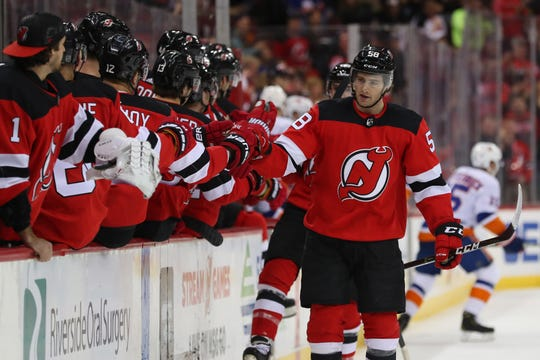 Feb 7, 2019; Newark, NJ, USA; New Jersey Devils center Kevin Rooney (58) celebrates with teammates on the bench after scoring a goal during the first period of their game against the New York Islanders at Prudential Center.