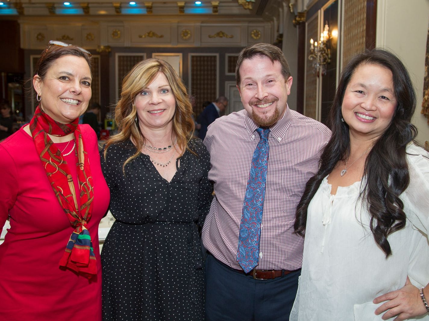 Executive Director Jennifer Brady, Tracey Gerber, Steve Simon, Que Lam.  A Night at the Races hosted by OASIS at the Brownstone in Paterson. 2/7/2019