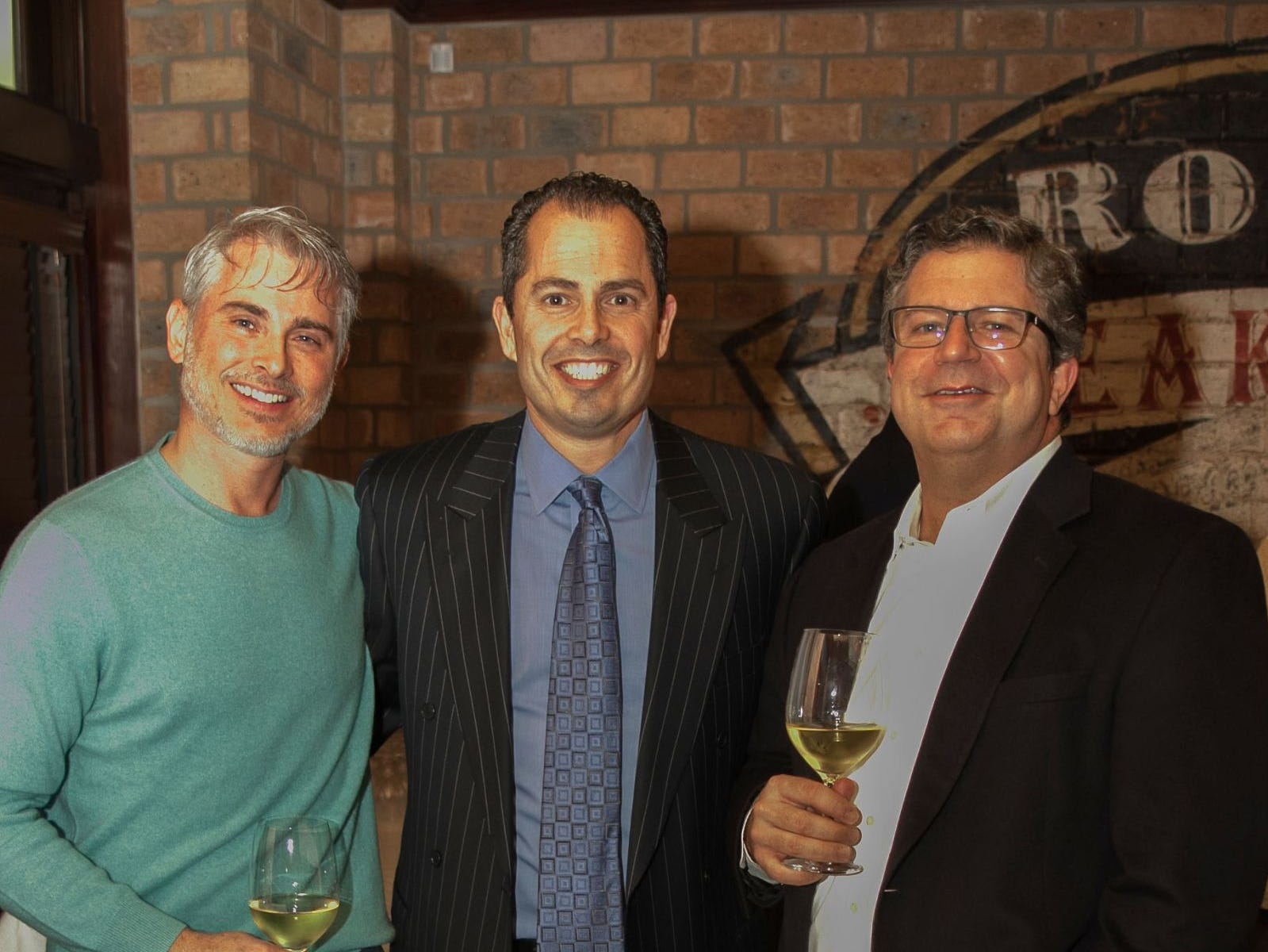Lou Reynolds, Pat Grande, Marc Chase. Christina Gibbons of Special Properties held a cocktail reception to acknowledge her clients at Roots Steakhouse in Ridgewood. 02/07/2019