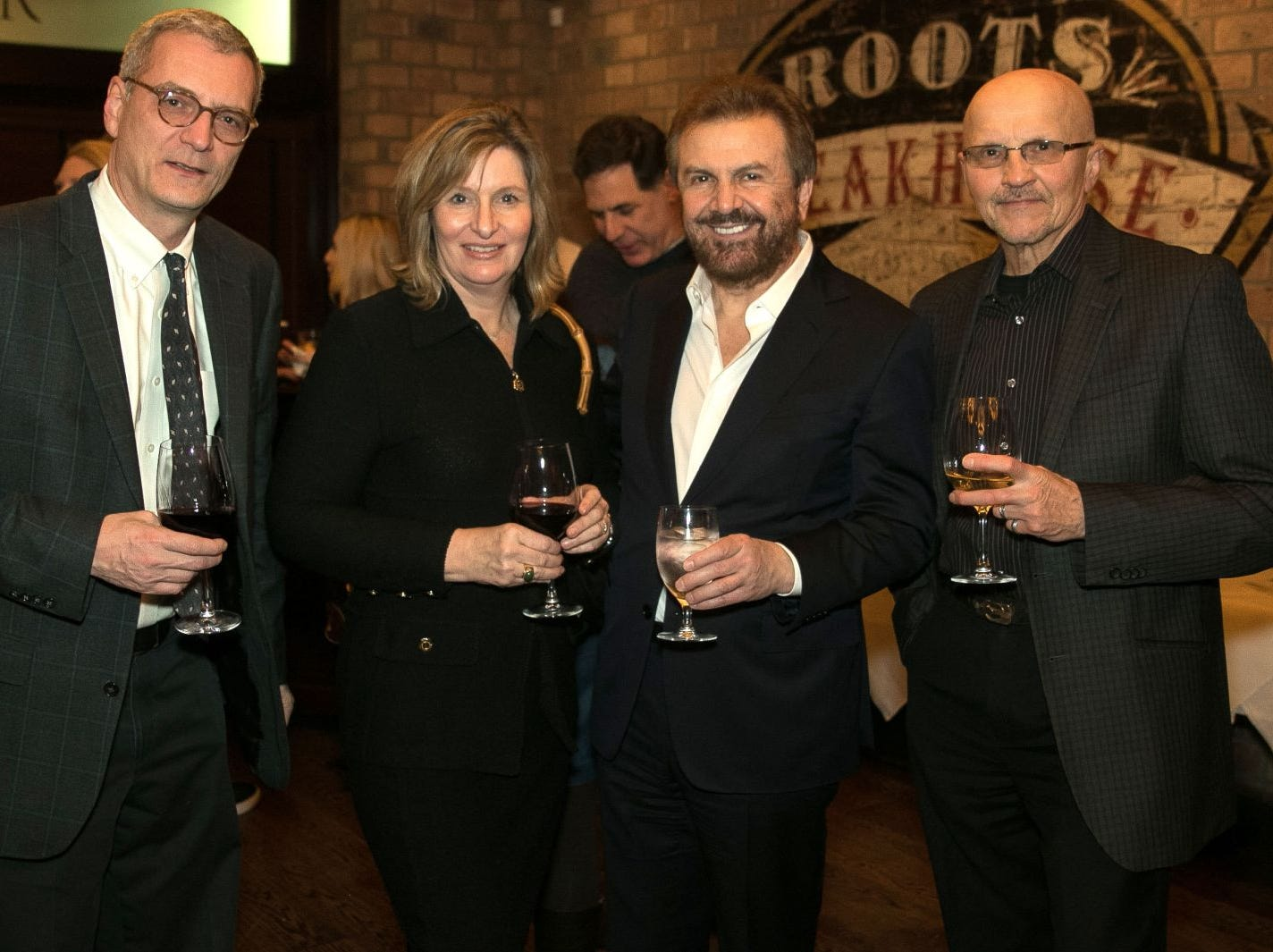 Glenn Garvie, Karen Mikelis, Ilija Pavlovic, James Emolo. Christina Gibbons of Special Properties held a cocktail reception to acknowledge her clients at Roots Steakhouse in Ridgewood. 02/07/2019