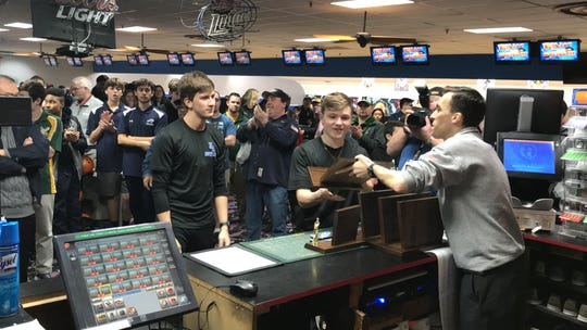 Eric McKenna (center) and members of the North Arlington boys bowling team accept the Group 1 trophy from tournament director Greg Hatzisavvas at the North 1B sectional on Thursday, Feb. 7, 2019 at Lodi Lanes.