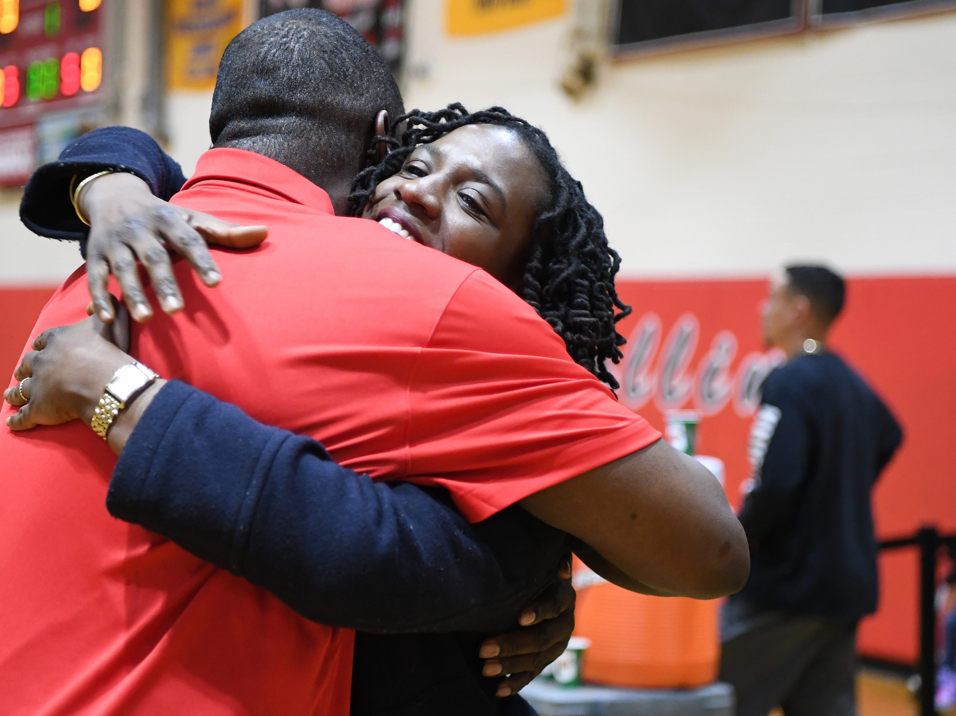 (center) Nicole Louden, who graduated from Kennedy High School in 2001 with a career total of 2,928 points, is honored in a pregame ceremony before the start of a Kennedy girls varsity basketball home game on Thursday, February 7, 2019. Louden hugs Kennedy girls varsity basketball coach MarQuette Burgess.