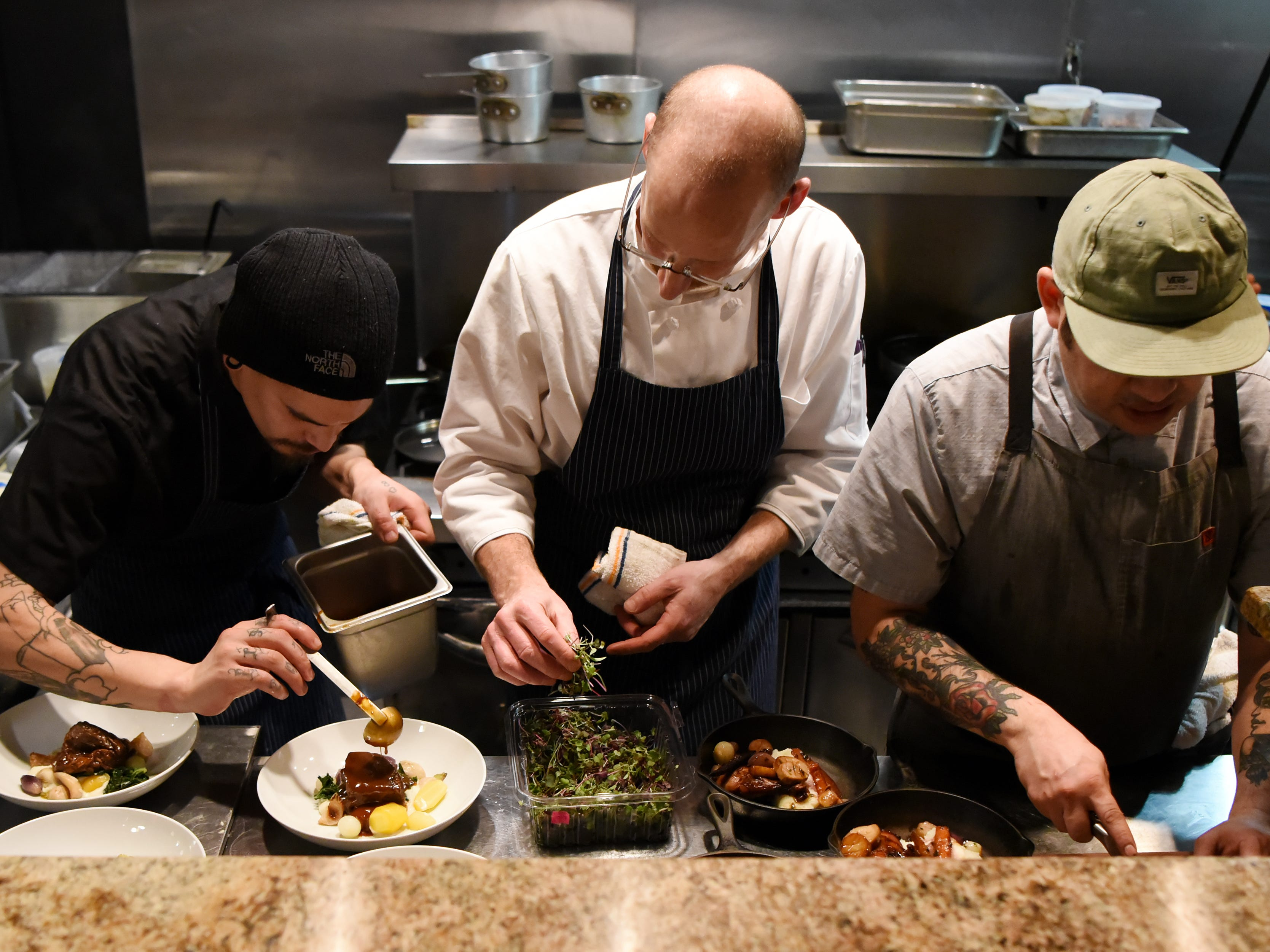 (From left) Sous chef Elvis Alvarez, Chef/Owner Ross Goldflam and Chef de cuisine Jonathan Pacheco plate dinners during the dinner with Esther event at Technique, a French restaurant in Westwood on Thursday February 7, 2019.