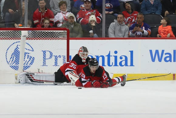 Feb 7, 2019; Newark, NJ, USA; New Jersey Devils center Nico Hischier (13) blocks a shot during the second period against the New York Islanders at Prudential Center.
